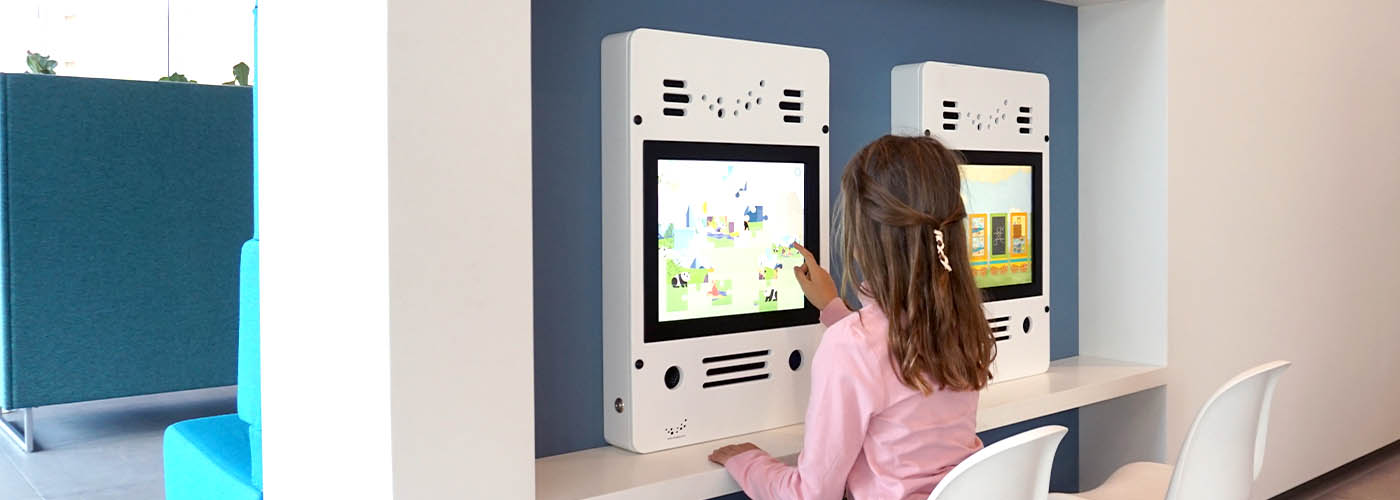 this image shows a kids corner with interactve play system in a town hall